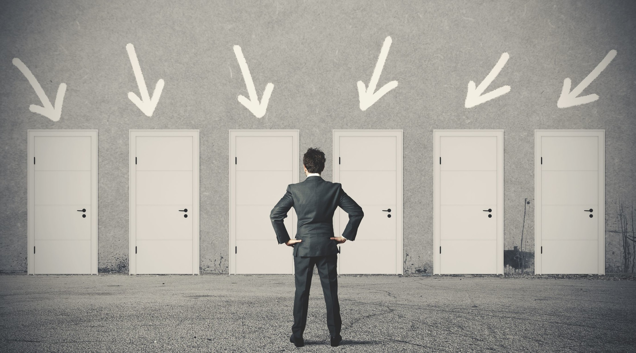 Man Deciding Which Door To Choose